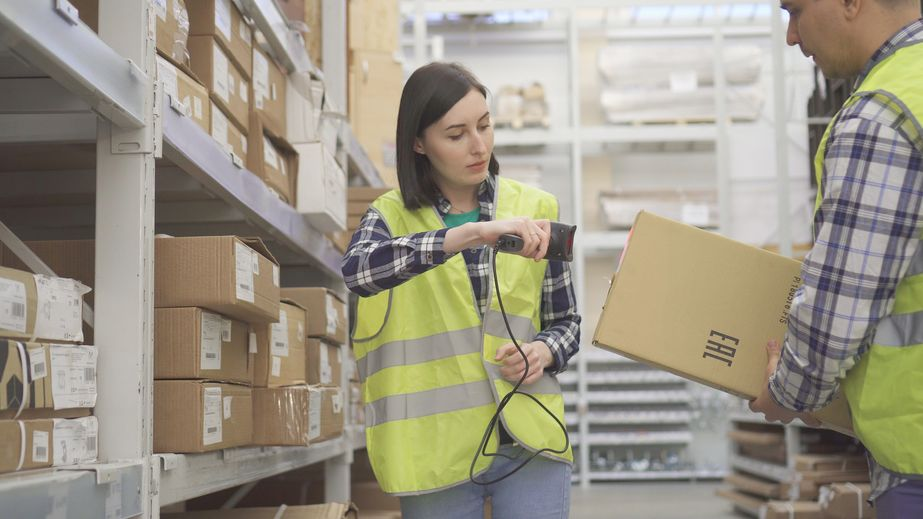 Warehouse worker scans the product barcode scanner