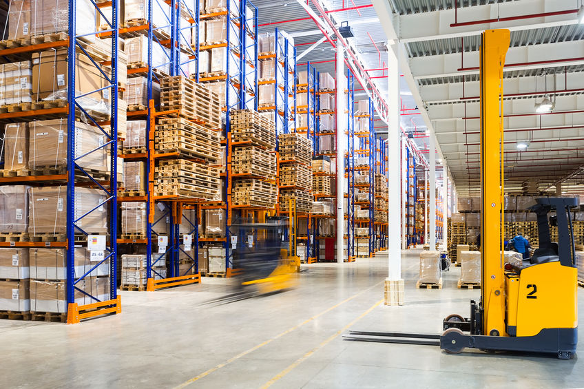 Large modern warehouse with forklifts