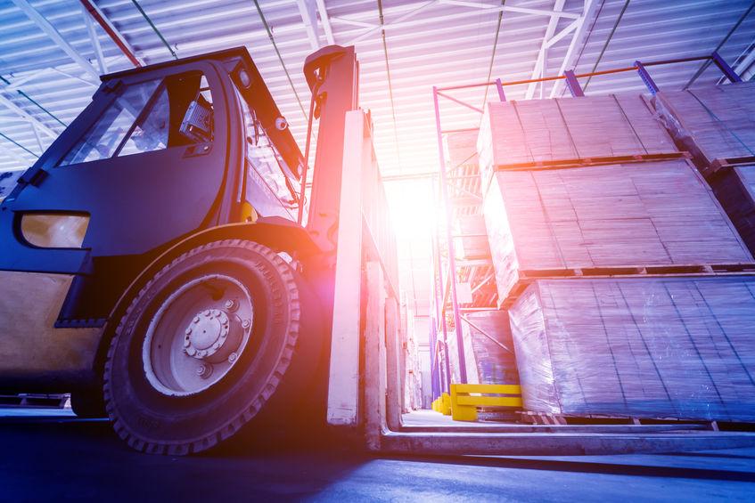 Forklift loader lifting pallets in warehouse